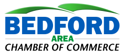 The Logo of the Bedford Area Chamber shows mountains and the name in blue and green.